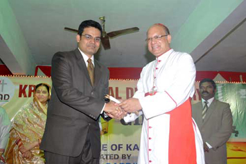 Receiving the Director-in-charge Kripa Dispensary citation  from Cardinal Oswald Gracias
